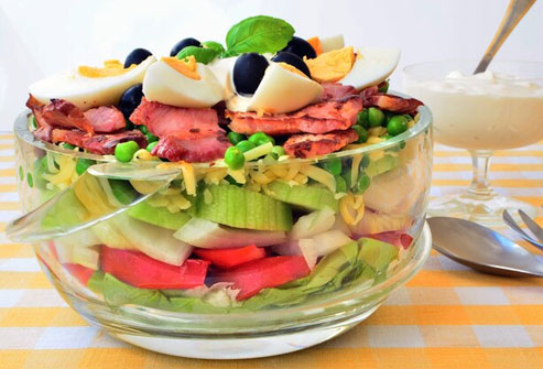A 7-layer salad with eggs, cheese, and bacon is not health food.