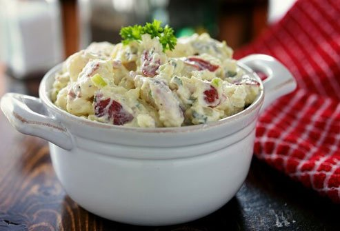 Swap German potato salad for the kind made with mayo to serve up less fat and calories.
