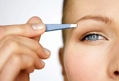 Photo of tweezing brows.