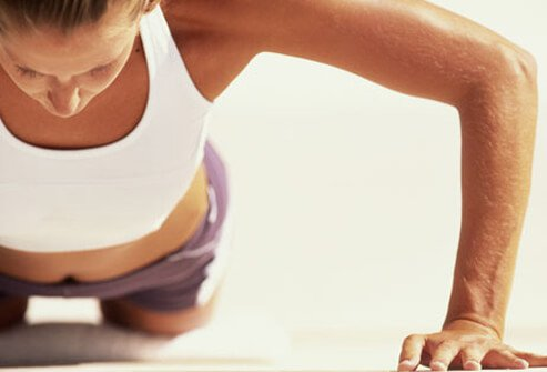 Photo of a woman doing push-ups.