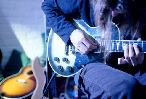A man plays an electric guitar.