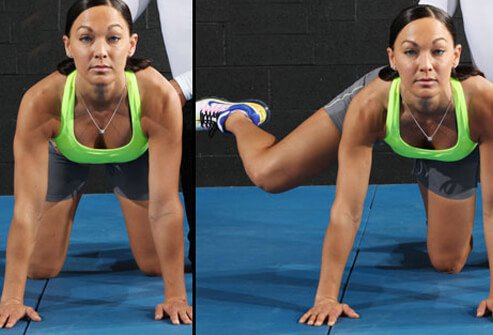 A woman showing the proper technique for the dirty dog exercise.