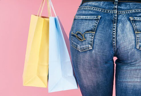 A woman wearing form fitting jeans.