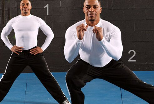A man doing a side lunge exercise.