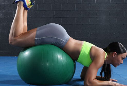 A woman doing a hip lift on an exercise ball.