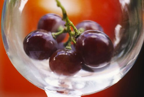 Red grapes in a glass bowl.
