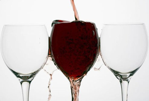 Red wine spilling out of a glass.
