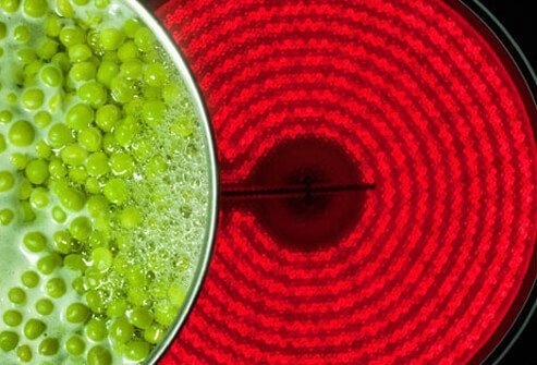 Boiling peas on a hot stove top.