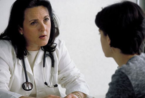 Photo of a doctor discussing celiac disease with a woman.