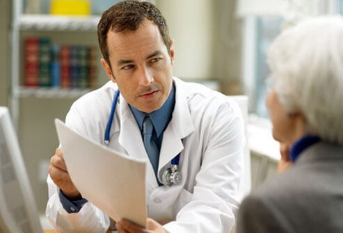 A doctor discussing colon cancer options with a patient.