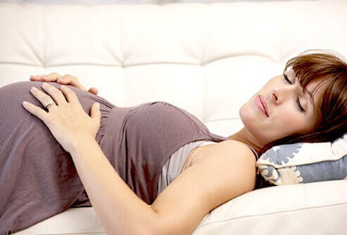 A pregnant woman resting.