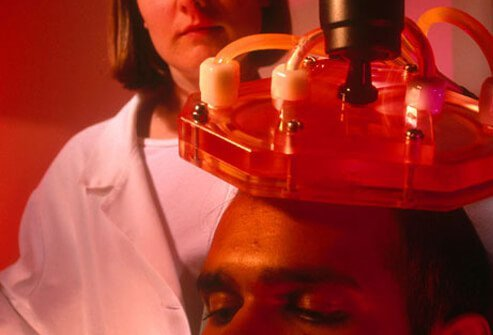 A man receives transcranial magnetic stimulation.