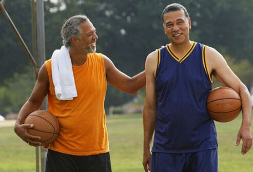 A couple guys playing basketball.