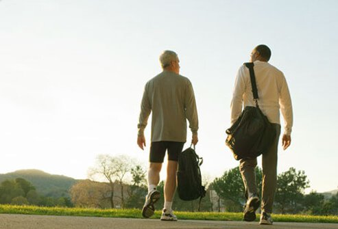 Two men walking with gym bags.