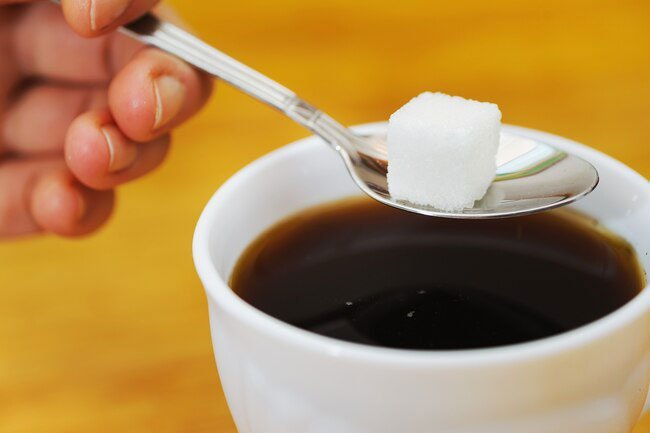 A spoonful to take the edge off your coffee will not directly make cancer cells grow faster.
