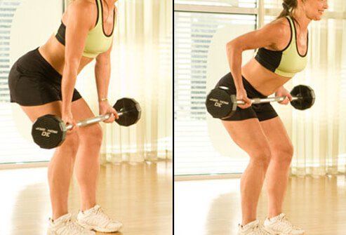 A trainer performing an upright row with barbells.