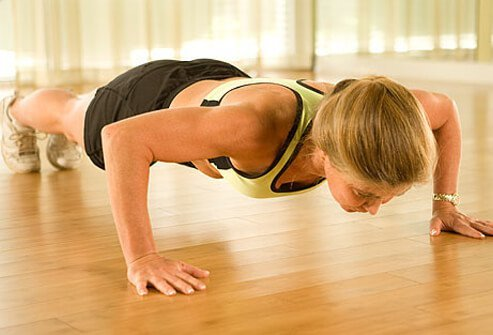 A trainer demonstrating a push-up.