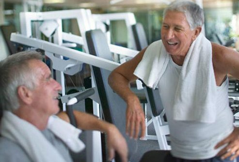 Photo of older men at talking at the gym.