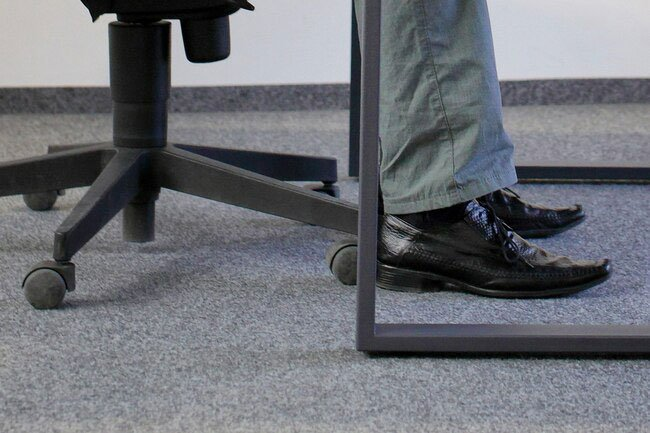 Always make sure your feet are on the floor for good office ergonomics.