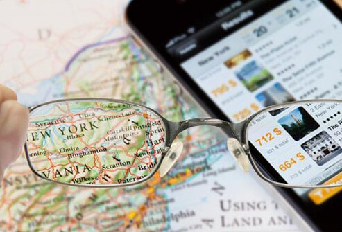 Photo of reading glasses and map.