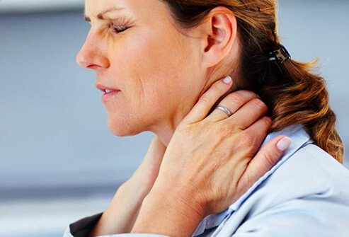 A woman suffering from fibromyalgia pain.