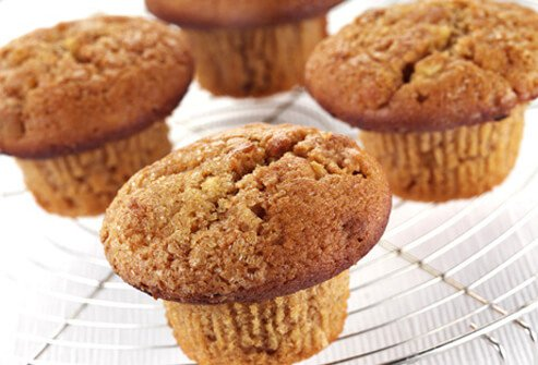 A photo of bran muffins on cooling rack.