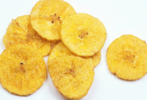 A photo of banana chips on a white table.