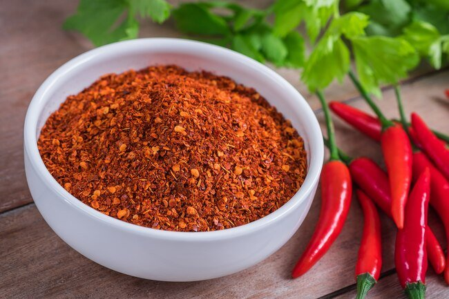 Capsaicin in peppers relaxes muscles in blood vessels improving blood circulation.