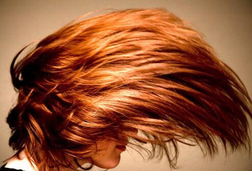 Photo of red hair style.