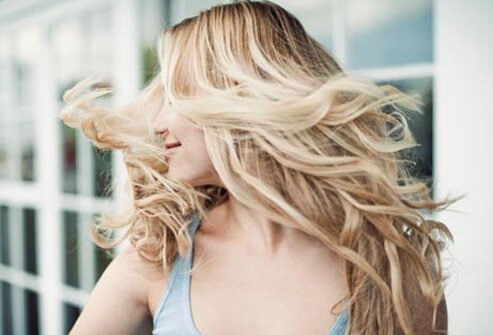 Photo of woman shaking hair.