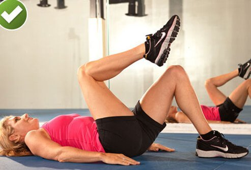 Follow these directions to perform a safe knee-to-chest workout.