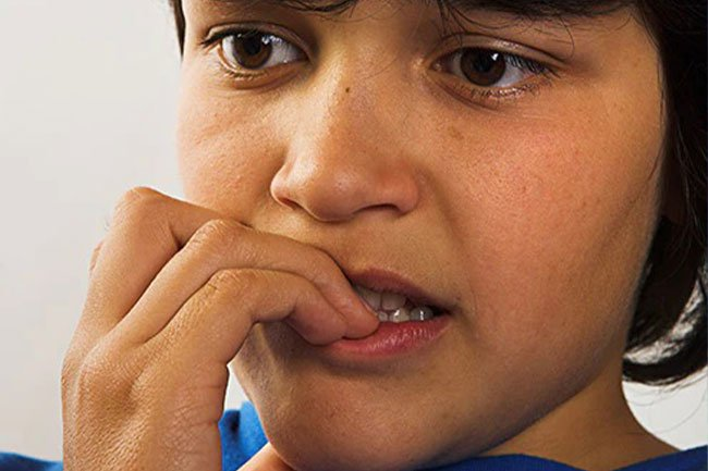 Kids chewing on their fingernails, keys, pencils, hair, or dog toys is a normal habit.