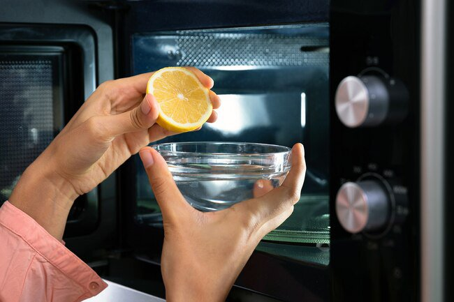 Use baking soda, lemon juice, and water to clean the microwave.