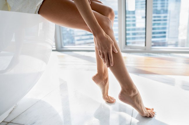 Baby oil is a good moisturizer for your legs, hands and feet.