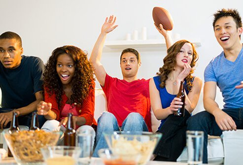 A group of friends watching sports.