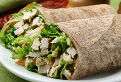 A grilled Caesar chicken wrap on whole wheat tortillas.