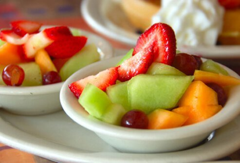 Side order bowls of fresh fruit.