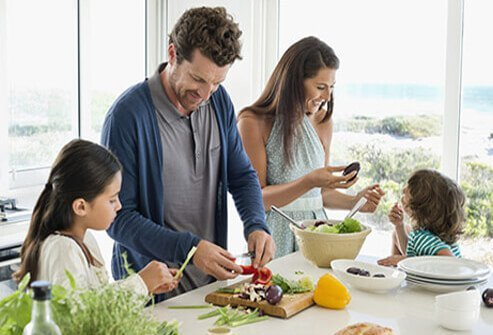 A family preparing a healthy meal.