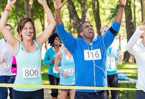 Excited runners finish a marathon.