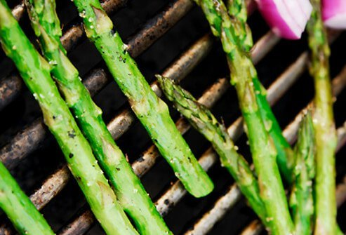 Asparagus cooking on the grill.