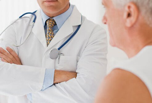 A photo of a man talking with his doctor about portal hypertension.