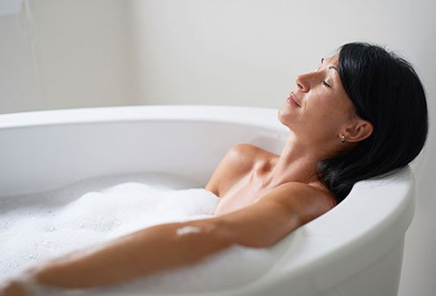 A hot bath can help ease pain and improve blood flow.