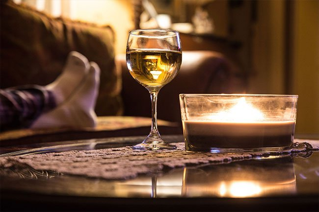 You may think a beer or glass of wine before bed helps you fall asleep.