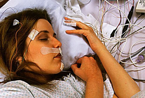 Photo of a woman undergoing a sleep study.