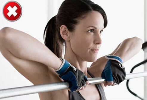 Pulling weights, a barbell, or a weighted cabled bar up under your chin can compress the nerves in the shoulder area.