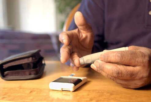 A man performing a blood glucose test, diabetes can cause low testosterone.