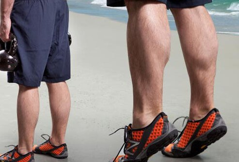 Stand with dumbbells or kettlebells at your sides, feet shoulder-width apart.