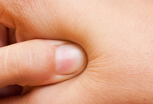 Another spot you can target for tension relief is the fleshy pad between your thumb and first finger.