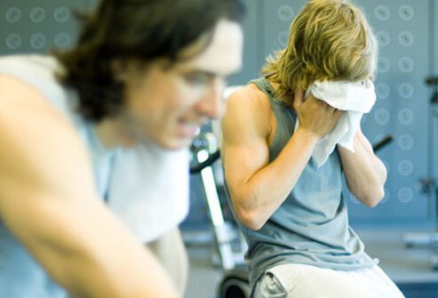 Two men work out in the gym.