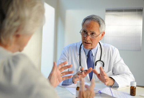 A health care practitioner discusses multiple sclerosis goals with a patient.